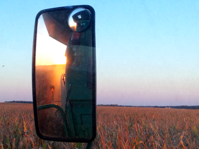 combine corn sunset