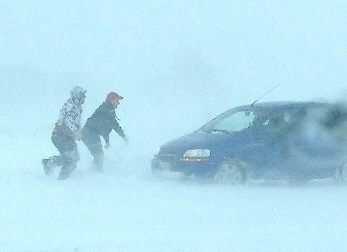 car pushed out of snow